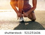 runner ties his shoes | Shutterstock . vector #521251636