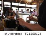 preparing the bill at a... | Shutterstock . vector #521260126