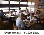 couples relaxing over lunch in... | Shutterstock . vector #521261302