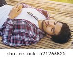 young man sleep on bamboo bed. | Shutterstock . vector #521266825