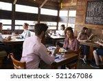 mixed race couple enjoying... | Shutterstock . vector #521267086