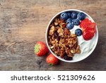 bowl of homemade granola with... | Shutterstock . vector #521309626