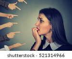anxious woman judged by... | Shutterstock . vector #521314966