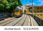 Old-fashioned bonde tram travels near Largo dos Guimarães, the heart of the hillside neighborhood of Santa Teresa in Rio de Janeiro, Brazil