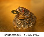 three legged toad with gold coin | Shutterstock . vector #521321962