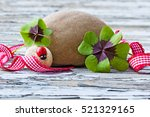 Stock photo wood background with four leaf clover and stone copy space 521329165