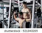 young man and personal trainer... | Shutterstock . vector #521343205