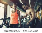 personal trainer helping woman... | Shutterstock . vector #521361232