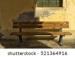 Wooden Bench Under A Porch