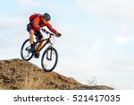 Cyclist in Red Jacket Riding the Bike Down Rocky Hill. Extreme Sport Concept. - stock photo