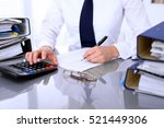 Small photo of Bookkeeper or female financial inspector making report, calculating or checking balance. Internal Revenue Service checking financial document. Audit concept.