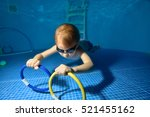 The Child Swims And Trains...