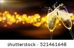 two glasses of champagne over... | Shutterstock . vector #521461648