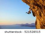 rock climber jumping on...   Shutterstock . vector #521528515