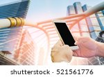 man hand holding smart phone on ... | Shutterstock . vector #521561776