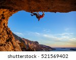 male climber on overhanging... | Shutterstock . vector #521569402