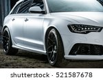 Kiev, Ukraine - 14 May 2014: Audi RS6 tuning sport-car. It colored in white color. Editorial photo. Closeup side view. - stock photo