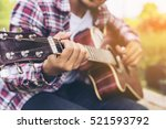man 's hand playing guitar ... | Shutterstock . vector #521593792
