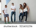 Small photo of teen boys get acquainted with the girls on the street