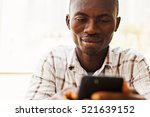 african man using smartphone | Shutterstock . vector #521639152