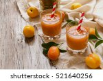 fresh apricot juice in a glass... | Shutterstock . vector #521640256
