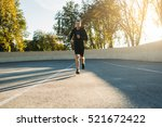 young sportsman running to... | Shutterstock . vector #521672422