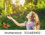 Stock photo laughing cute child with a butterfly on his nose and hands fairy dreams for princess girl happy 521683402