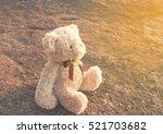 fluffy bear doll looks sunset... | Shutterstock . vector #521703682