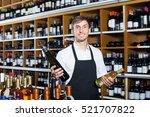 smiling seller man wearing...   Shutterstock . vector #521707822