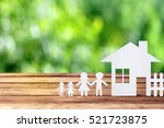 paper family on wooden table... | Shutterstock . vector #521723875