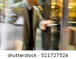 businessperson walking through... | Shutterstock . vector #521727526