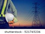engineer holding a white helmet ...   Shutterstock . vector #521765236