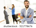young businessman standing in... | Shutterstock . vector #521778676