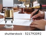 notary public in office signing ... | Shutterstock . vector #521792092