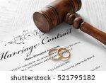 golden wedding rings with judge ... | Shutterstock . vector #521795182