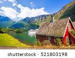 red cottage against cruise ship ... | Shutterstock . vector #521803198