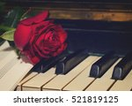 red rose with notes paper on... | Shutterstock . vector #521819125