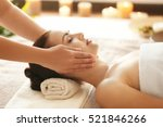 Small photo of Spa concept. Young woman enjoying of facial massage in spa salon