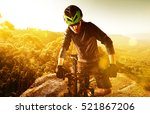 mountain biker having a break | Shutterstock . vector #521867206