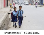 Small photo of KATHMANDU, NEPAL - SEPTEMBER 29, 2016 : Young boy and girl going home from school after lessons at the local school in Kathmandu, Nepal