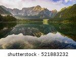 Stock photo autumn over alpine lake in the julian alps italy 521883232