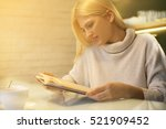 beautiful blonde woman reading... | Shutterstock . vector #521909452
