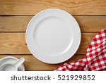 white dish on wood table food... | Shutterstock . vector #521929852