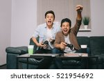two guys playing on the console ... | Shutterstock . vector #521954692