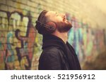 handsome man in headphones... | Shutterstock . vector #521956912