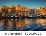 Stock photo fantastic sunset that shines on buildings and reflected in the water amsterdam is the capital and 522029122