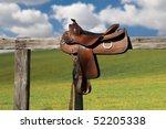 Horse Saddle On Rural Fence