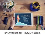 Small photo of Laptop computer, tablet pc and User experience concept on wooden office desk with copy space. Design concept background with rocket.