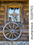 Old Wagon Wheel On Wall Of The...