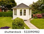 White Closed Gazebo In Garden...